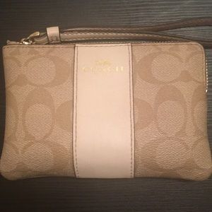 White and Tan Coach Wristlet